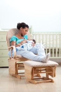 stock-photo-19635344-woman-with-baby-in-a-rocking-chair